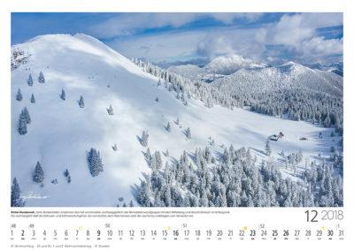 Winter-Wunderwelt<br>Zarte Wolkenfelder umrahmen den tief verschneiten Jochberggipfel in der Benediktenwandgruppe mit dem Mitterberg und Hirschhörnlkopf im Hintergrund. Die Jochbergalm lädt die Skitouren- und Schneeschuhgeher, die von Kochel, dem Walchensee oder der Jachenau aufsteigen, zum Verweilen ein.